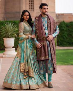 Light blue bridal lehenga and grooms kurta by Tarun Tahiliani