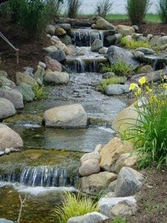 What the Heck is a Pond-Free or Pondless Waterfall? If you don't know what a pond-free waterfall is yet, have no fear I will explain . Backyard Stream, Garden Stream, Backyard Water Feature, Ponds Backyard, Garden Waterfall, Waterfall Fountain, Pond Landscaping, Landscaping With Rocks, Water Pond