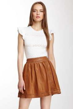 Scalloped Ruffle Short Sleeve Sweater and a lovely embossed leather pleated skirt. Such a great look !