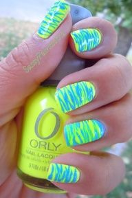 neon yellow nails with blue zig zags 2013