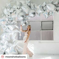 WEBSTA @balloonbar.ca Inspired with this monochrome cosmic balloon garland made of shiny mylar  balloons . What an idea for Xmas  parties !