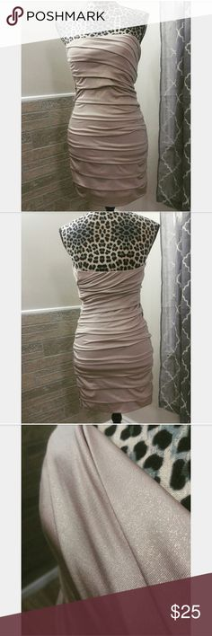 Gold Bandage Style Dress Shimmery in lighting.  Super slimming.  94% polyester, 6% spandex.  Strapless and sexy! Dresses