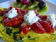 Tomato, Spinach, Goat Cheese Omelette    2 large eggs (160)  1 ounce goat cheese (75)  1/2 tomato (15)  spinach (0)     Nutrition:  250 calories, 19g protein