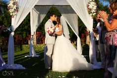 First kiss as man and wife in this lovely destination wedding garden ceremony at @riuhotels in Playa del Carmen. Mexico wedding photographers Del Sol Photography