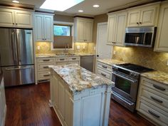 Painted Kitchen with Glaze, but note the under cabinet lighting and the tile backsplash