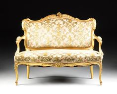 A THREE PIECE ROCOCO REVIVAL PARCEL GILT CARVED WOOD : Lot 221
