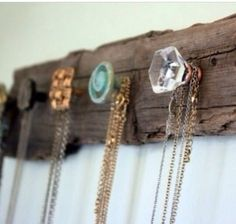 Fix vintage knobs on to a piece of driftwood - a stunning way to store your necklaces