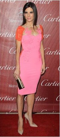 Sandra Bullock is rocking this pink dress with no doubt