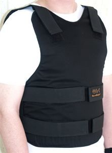 This bulletproof vest has Hook & loop bands, having fabric endings are folded inside and sewed threw all layers of fabric.