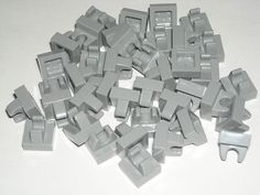 LEGO 40 Light Bluish Gray Tiles Modified 1x1 with Clip 7930 $1.99