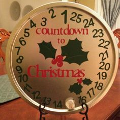 Advent Calendar  Dollar Store pizza pan, Vinyl numbers, lettering and graphic cut out with Cricut machine. Magnet to mark day.