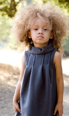 love this dress and if my daughter had this texture of hair, i'd sooooooooo do her hair like this lol