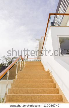 Main stair, with sand wash finishes, leading to ground floor with twilight blue sky background