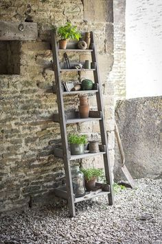 Shelf Ladder. Our rustic wooden Shelf Ladder is not only suitable outdoors as a decorative stand for plant pots or as a useful additional storage unit for any potting shed or greenhouse but would look marvellous indoors too for a more rustic relaxed style of interiors.