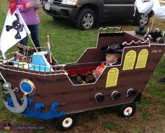 Sherrie: This is my grandson! My daughter asked if I could make his wagon into a ship. I had no clue. I took large Lowes boxes and opened them flat on...