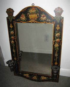 Antique toile tole mirror with candle holders