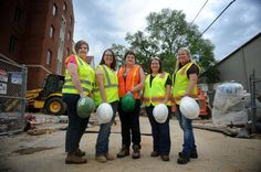 CAITIE MCMEKIN / NEWS SENTINEL Mary Kilburn, of Messer Construction, Erin Harlow, of Michael Brady Inc., Lois Adcock, of Keenland Heights, Nicole Franse, of S&ME Inc., and Emmy Buckingham, also of S&ME Inc., pause for a photo in front of construction at University of Tennessee on Friday, July 15, 2016. The five women are part of the South East chapter of the National Association of Women in Construction, which is celebrating it's 50th Anniversary this year.