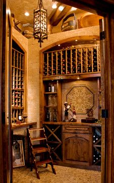 Wine Grotto Created From Unused Closet mediterranean-wine-cellar