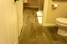 Tile flooring that looks like wood flooring to be tough, moisture resistant, and easy to maintain.