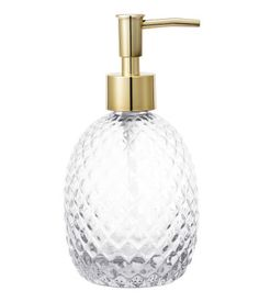Soap pump in textured glass with a plastic pump at top. Size approx. 3 1/4 x 4 3/4 in.