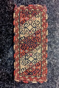 A majestic and very fine antique silk embroidered Turkoman Turkmen talismanic armband (bazooband) attribute to Yomud / Yomut tribes. Dating to the 19th century, this fantastic Central Asian embroidery has wonderful workmanship  ...