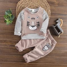 Stylish Striped Long-sleeve T-shirt, Tiger Print Vest and Pants Set for Baby and Toddler Outfits Niños, Family Outfits, Kids Outfits, Baby Outfits Newborn, Baby Boy Outfits, Baby Boy Suit, Baby Boutique Clothing, Designer Kids Clothes, Tiger Print