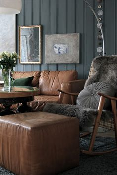 inspiration photo: camel leather grey walls fur accents basement