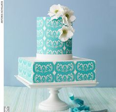 Teal-patterned and printed fondant wedding cake accented with sugar flowers and white trim by Bijoux Doux by Ellen Baumwoll, BijouxDoux.com  > Find your wedding cake baker
