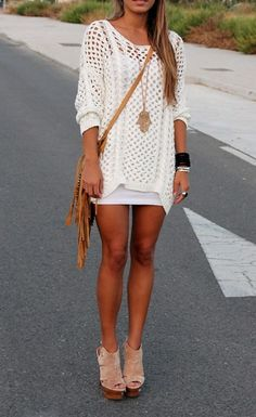 Hmmm... I have a VS black tank dress and a tan knit sweater... I may wear it just like this! If I need to get this!