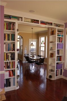 Use bookshelves to provide functional, stylish separation between rooms. This is exactly what I want. Tips for convincing my wife to let me build them for my living room?