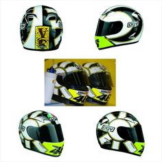 AGV Gothic Helmet (Black)2006 - The AGV Gothic helmets come in 3 main colour variations – White, Yellow, and Black. This features the same design as all other Rossi Gothic helmets, except it features a white sun and black moon on a black background. It was has been used on a regular basis and the Gothic Black was ofter favoured in practice or qualifying sessions, with Valentino switching to the Gothic Yellow for race day.