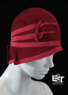 The maroon cloche hat in the Museum of Texas Tech Collections has a lighter-hued maroon grosgrain ribbon trim, and is lined with light tan fabric.