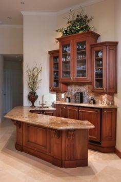 Beautiful bar area- Would love this for all my coffee & tea stuff that is overcrowding my pantry & countertop!