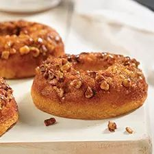 A baked doughnut that mimics the flavors of a sticky bun.