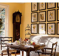 cheerful paint colors with dark wood | sunny breakfast nook invites with soft orange-yellow walls. Dark wood ...
