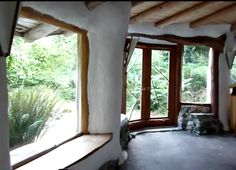 Big windows help the cob interior to not feel too enclosed. Not sure I like the wobbly lines though.