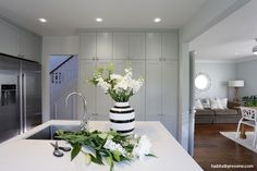 The kitchen cabinetry is painted Resene Half Delta which not only complements the Resene Half Duck Egg Blue walls but balances the Resene Delta doors throughout the rest of the house. Designer Kelly Gammie of Eucalyptus Design. Photography by Becky Nunes. Gray Blue Dining Room, Taupe Living Room, Hamptons House, The Hamptons, Duck Egg Blue Wall, Computer Nook, Blue Subway Tile, New Staircase, Painted Cupboards