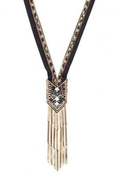 Stay on-trend with the Nile Necklace! With gold fringe and a hand beaded boho-chic fabric pendant, this necklace will complement your latest look.