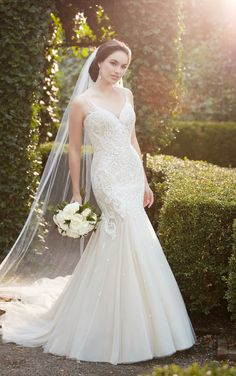 A modern-meets-glam style, this heavily-beaded mermaid wedding dress from Martina Liana is showstopping! Lace is hand-embroidered with beading, creating unique scroll patterns throughout the bodice and hips of this Lace and Tulle over Regency Organza gown. Modern, linear beading highlights the tulle straps and back of this style, and the pattern continues throughout the full …