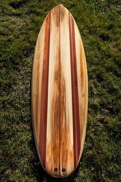 Channel Islands Biscuit wooden surfboard.