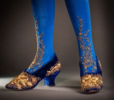 Shoes ca. 1890. Helen Larson Historic Fashion Collection. Blue velvet embroidered shoes, stockings.