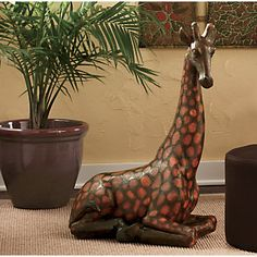 Giraffe from Midnight Velvet. www.midnightvelvet.com  The giraffe is one of those remarkable animals that combine an ungainly silhouette with grace. This charming sculpture captures that very quality, depicting a giraffe at rest, its legs tucked beneath its body, long neck extended in an attitude of alert repose.