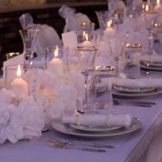 Dinner party with paper flower centerpieces