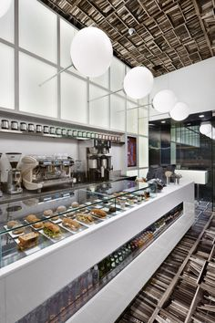 The books are on the ceiling, no big...  Nema Workshop's rendition of a Madison Avenue Espresso Cafe...