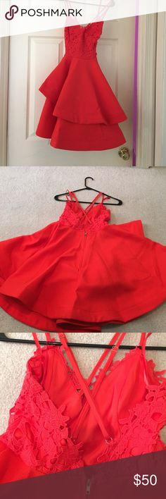 Hello Molly Fashion red formal dress Size Small. Worn once to a formal and received many compliments. Fire truck red color. Has lace design on the chest. The bottom has many layers that ruffle out. This dress has a criss cross back and double straps for the front. It has straps that criss crosses at your neck. Straps are adjustable.  Lower back has a zipper. Perfect for formals, weddings, prom, sweet sixteens etc hellomollyfashion Dresses