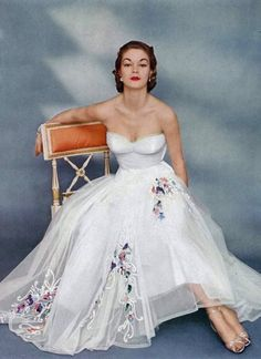 Jean Patchett in Kiviette 1951 fashion style vintage dress evening gown white strapless floral embroidery tulle 50s full skirt color photo print ad model magazine
