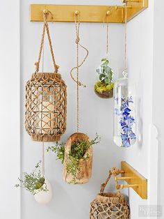 Who cares what's around the corner when the corner looks this good? Hanging lanterns and indoor shrubs redefine a coat rack (and garden, too!)./
