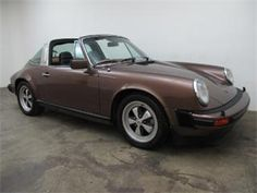 1978 Porsche 911SC Targa with matching numbers - chassis #9118310799 and engine #6381780. This is an ultra-rare right hand drive that comes in copper brown metallic (original color code 443) with tan interior and is equipped with 5-speed manual transmission.