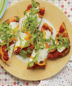 A pizza bar is a great way to get kids involved in the kitchen. Set out the toppings and cheese and let them build their own pies on easy-to-handle flat breads or pocketless pitas.