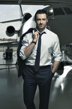 """Following last year's Montblanc campaign, which centered around the brand's Meisterstück pen, Hugh Jackman reunites with the label as modern trailblazers are profiled. Photographed by Mikael Jansson, the Australian actor poses in a hangar, donning a sharp suit and Montblanc's choice timepieces. Discussing the advertisement, Montblanc CEO Jerome Lambert shares, """"With this new campaign, we …"""